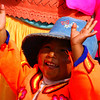 Today's Smiling Faces Travel Photo is of a small child happily singing from the Uros people who live on Lake Titicaca nearby Puno, Peru.