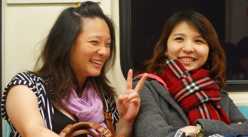 Today's smiling faces travel photo is of two Taiwanese ladies enjoying a smile and a laugh on the metro in down town Taipei, Taiwan.