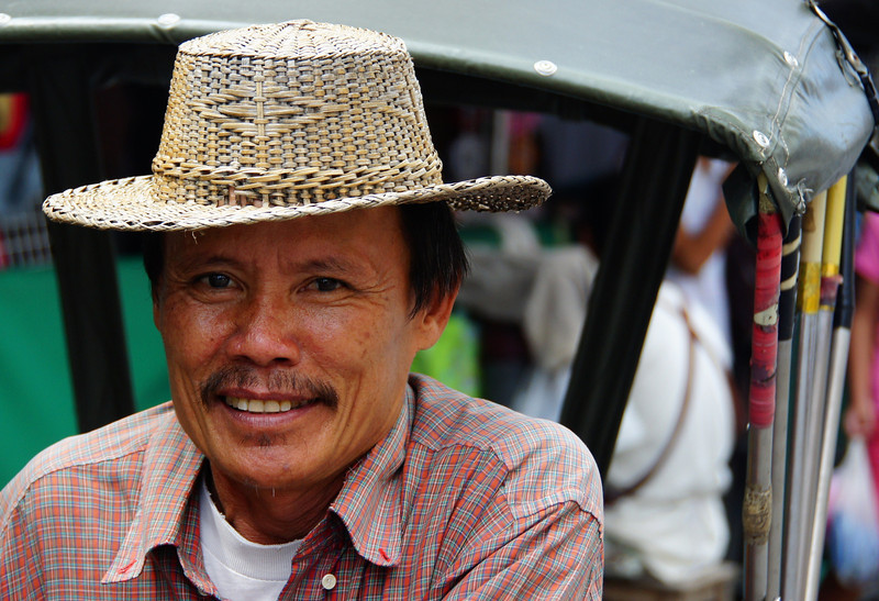 """<a href=""""http://smilingfacestravelphotos.com"""">http://smilingfacestravelphotos.com</a> : My daily smiling faces travel photos is of a Thai man (rickshaw driver) who gave me excellent service in Chiang Mai, Thailand."""