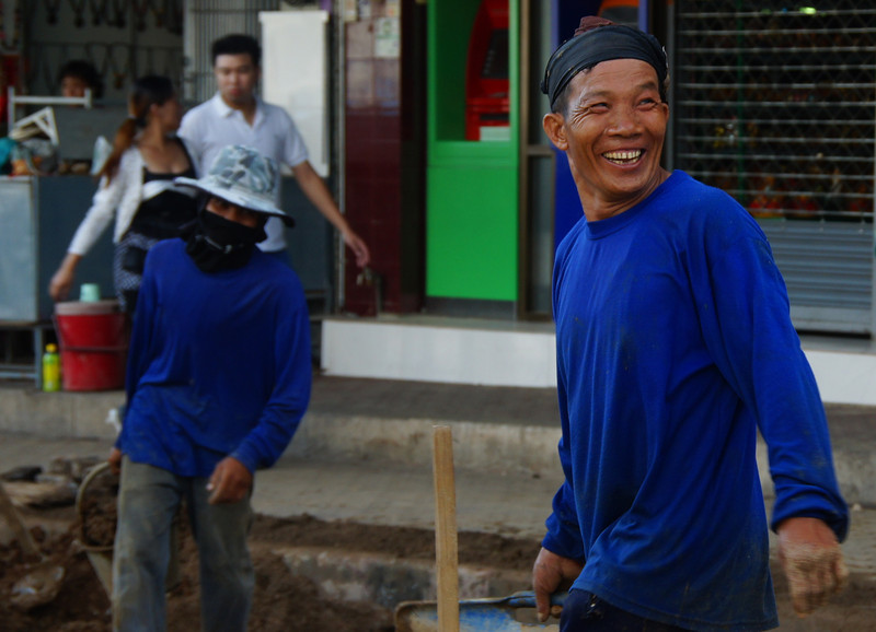 Today's smiling faces travel photo is candid shot of a happy Thai worker beaming a big authentic grin nearby Chiang Rai, Thailand.