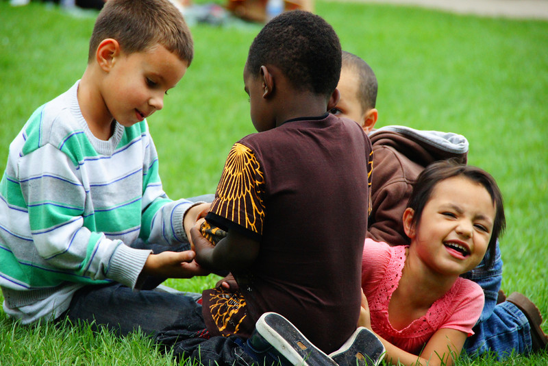 Today's lovely smiling face of the day is a shot of a group of children exuberantly playing at a local park in Chicago, Illinois in the middle of the day.
