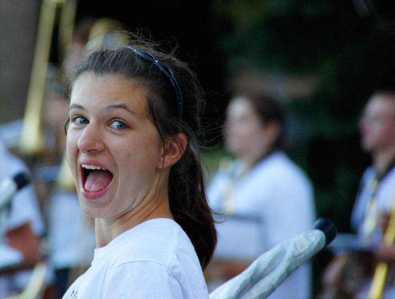 Today's smiling faces travel photo is of a teenage girl hamming it up and smiling for the camera while performing with her band outside the baseball stadium - Chicago, USA