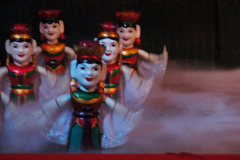 Today's smiling faces travel photo is of a series of Vietnamese water puppets displaying motion blur in Saigon, Vietnam.