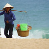 "<a href=""http://smilingfacestravelphotos.com"">http://smilingfacestravelphotos.com</a> : Today's smiling faces travel photo is of a Vietnamese local vendor carrying a yoke with fishing supplies at a beach in Nha Trang, Vietnam."