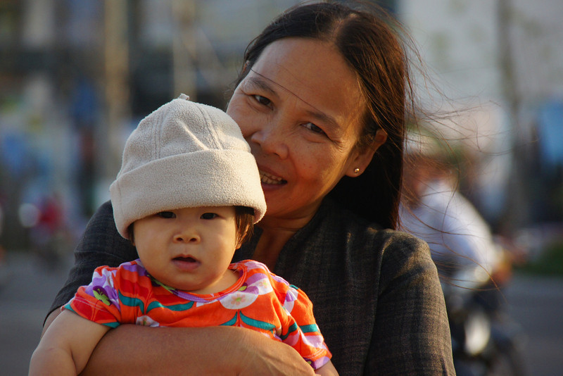 Today's smiling faces travel photo is of a loving Vietnamese lady clearly adoring the small child she is holding snuggling in her arms - Nha Trang, Vietnam.