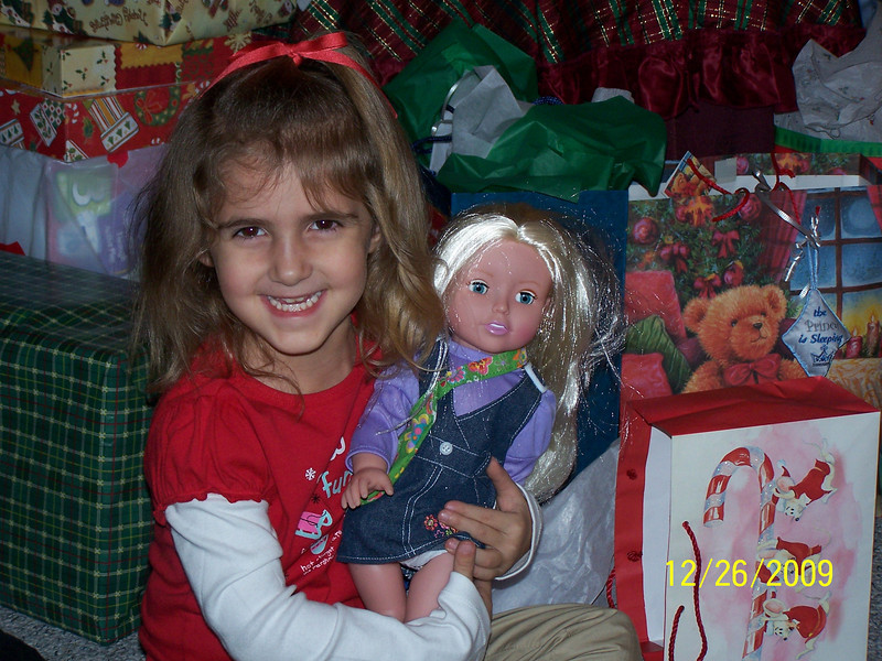 Jenna excited about her new doll baby.
