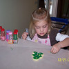 Olivia making christmas cookies with mommy.