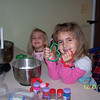 Jenna and Olivia making cookies with mommy.
