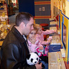 Daddy helping Jenna and Olivia get birth certificates for their new animals.