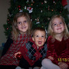 Jenna, Zachary and Olivia trying to pose for a christmas picture.