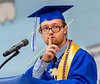 Jesse Euler makes a gesture to the graduating class while giving the second of three student addresses.