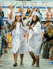 Esmeralda Castaneda, left, and Paulina Covian celebrate as they walk during the recessional.