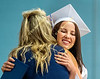 Riley Urton hugs Kathy Bomba-Edgerton, principal, after receiving her diploma.