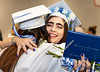 Paige Zaprzalka is hugged during a reception after the commencement ceremony.