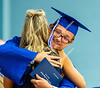Jesse Euler receives a hug from Kathy Bomba-Edgerton, principal, after accepting his diploma.