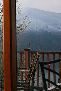 From inside the sunroom with a hot cup of coffee. Snow on Smith Mtn.  Spring 08'