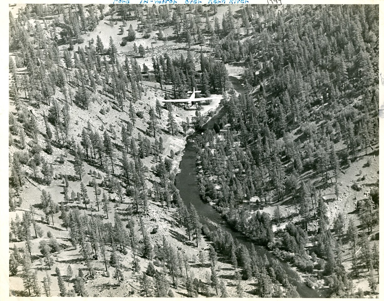 Tri-motor over the Kern River.  Probably enroute to the fire since it's headed upstream. 1949