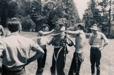 Bob Nolan (CJ-47) in jump suit, Bob Snyder (CJ-48) with back to photo, Starr Jenkins (CJ-48) (cap) Contributor: Albert Boucher