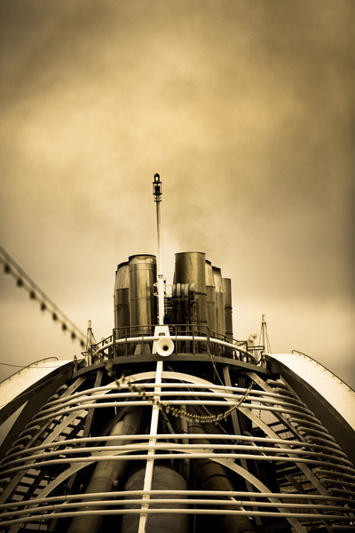 01/14/2013:<br /> I thought the smokestacks of the Cruise Ship were interesting looking, and is enhanced with the sepia tones.