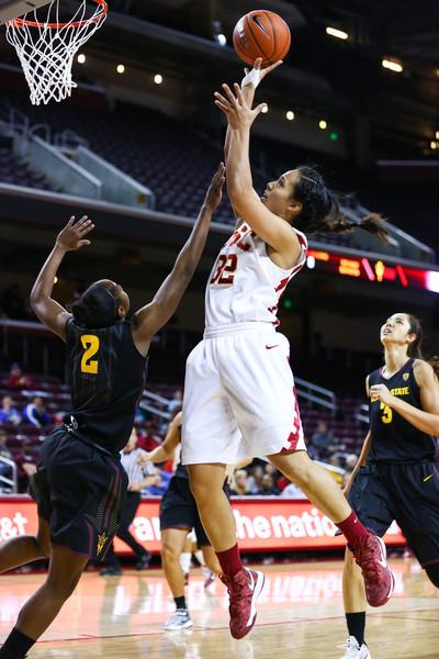 01/26/2013:<br /> Kiki Alofaituli, sophmore guard for the Women of Troy, puts up a layup against Arizona State.