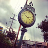 01/12/2013:<br /> A clock outside a Starbucks.  The combination of the clock, clouds, and line of poles was intriguing.