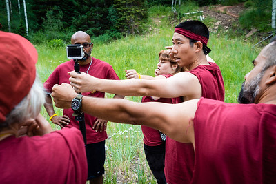 Ping demonstrates proper archery technique for Team Gold Rush