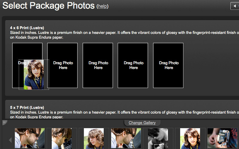 D) Drag the photos you want printed from the gallery to the empty black icons