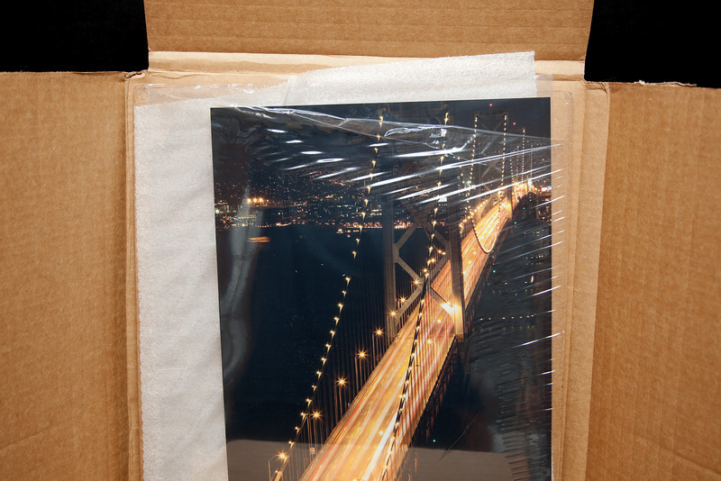 Photos are in an inside package-within-package.  Securely wrapped, soft foam paper, then shrink wrap around another piece of board.