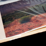 One corner of a 24x36 metallic print - again, in plastic, foam paper and then wrapped in a thick plastic sleeve.