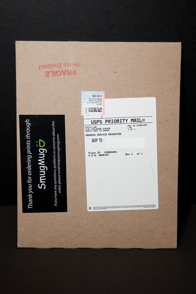 Heavy guage cardboard mailers for 8x12 and below, when they ship separately or as a small order.  These envelopes are orders of magnitude thicker than the standard USPS or Fedex or UPS mailer envelopes that other labs use.