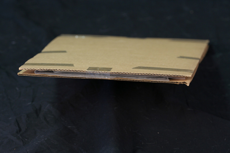 The photos from Bay are sandwiched between two layers of durable cardboard to protect them from the damages of shipping.