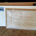 Now after opening the white box, there's my print, securely strapped to a sturdy piece of cardboard and wrapped in bubble wrap.