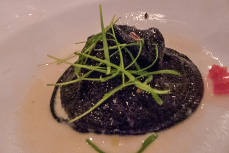 Squid Ink Escargot! That's right all of the things you wouldn't eat all rolled up into one .... it was very very good!