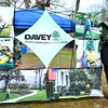 Debby High — For Montgomery Media<br /> Mike Chenail, an arborist with Davey, runs a booth at the Earth Day event.