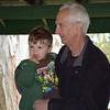 Debby High — For Montgomery Media<br /> Bruce Markley and his grandson, Garrett Traubel, listen to storyteller Bill Wood.