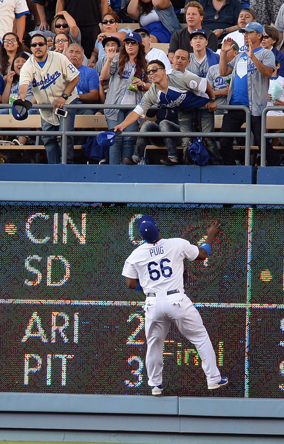 . Los Angeles Dodgers rightfielder Yasiel Puig watches a homerun fly over the wall against the Cleveland Indians July 1, 2014 in Los Angeles.(Andy Holzman/Los Angeles Daily News)