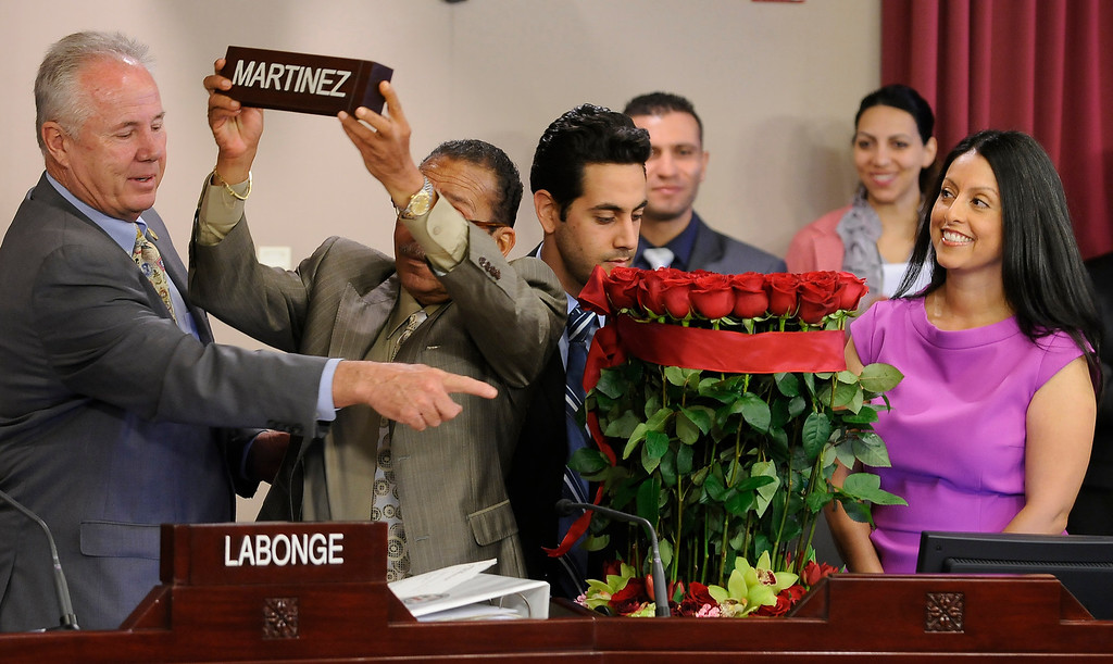 . Tom LaBonge points out to Herb Wesson where the name plate for Nury Martinez should go. Martinez is the newest Los Angeles City Council member, representing District 6. The council met in Van Nuys City Hall. Van Nuys , CA. 8/2/2013(John McCoy/LA Daily News)