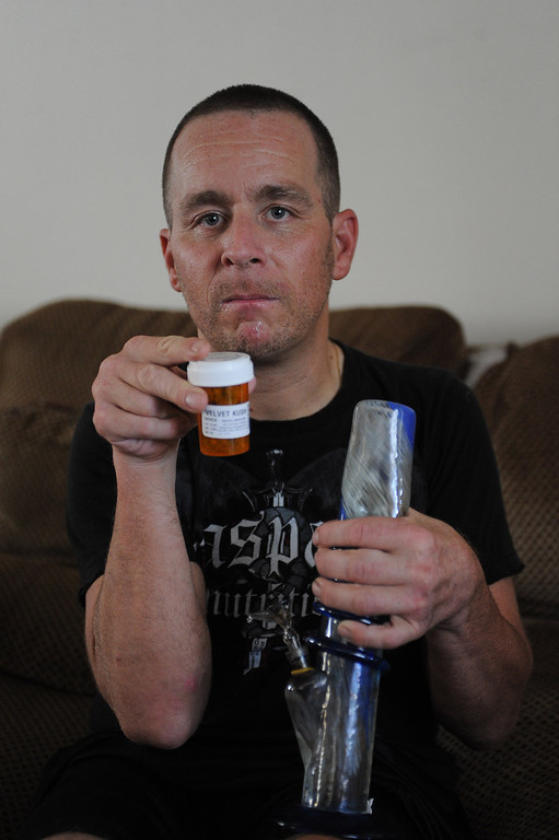 . Medical marijuana user Stevie Zee shows off his prescription that helps him cope with Cerebral Palsy. Valley Village, CA. 8/8/2013(John McCoy/LA Daily News)