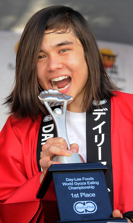 . Matt Stonie takes a bite out of the trophy after his win. The World Gyoza Eating Contest took place as part of the annual Nisei Week Foundation festival. Matt Stonie of San Jose ended up setting a new world record by eating 268 pot stickers, edging out last years winner Joey Chestnut who ate 251. Los Angeles, CA. 8/17/2013(John McCoy/LA Daily News)