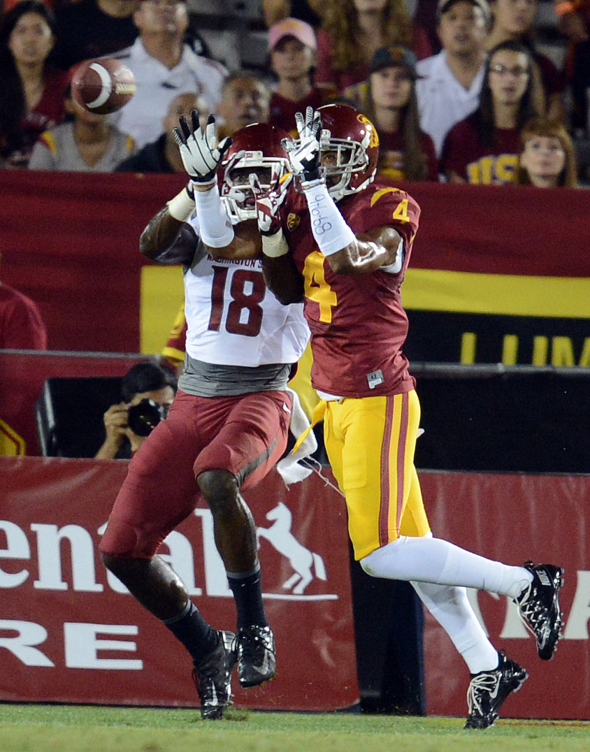 . USC\'s Torin Harris #4 intercepts a pass in the end zone intended for Washington State\'s Kristoff Williams #18 in the 1st quarter at the Los Angeles Memorial Coliseum  Saturday, September 7, 2013.  (Photo by Hans Gutknecht/Los Angeles Daily News)