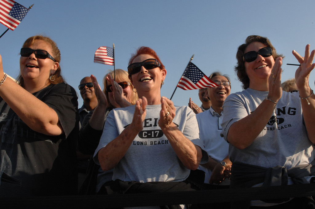 . 9/12/13 - L-R Dani Elledge, auditor, Patti Sambdman, forms management and Elizabeth O\'Neal, staff analyst cheer during the ceremony to deliver the final C-17 to the U.S. Air Force on Thursday morning. (Photo by Brittany Murray/Press Telegram)