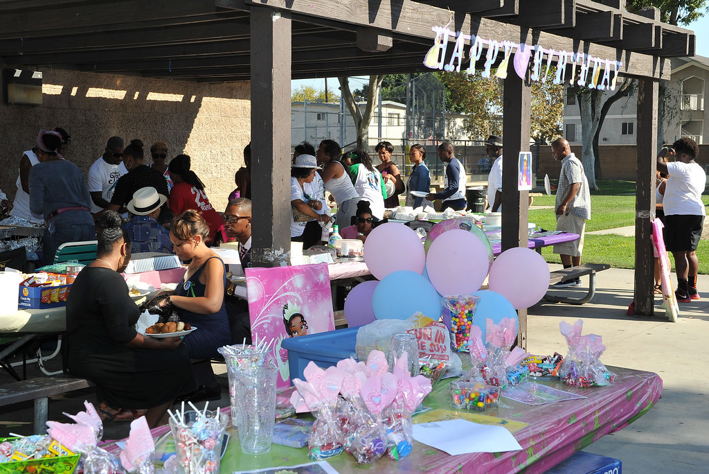 . 9/14/13 - After a morning funeral family and friends of Tiani Ricks gathered Saturday afternoon at Simms Park in Bellflower for her originally planned birthday party. Ricks was killed at a party in Moreno Valley a week before she would have turned 7 years old. She lived and attended school in Long Beach. (Photo by Brittany Murray/Press Telegram)