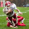 Fitchburg quarterback Darius Flowers dives for a first down. SENTINEL & ENTERPRISE / GARY FOURNIER