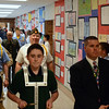Eighth grader, Justin DeFrancisco, drummer lead the processional of Veterans down the hall. Photo by Debby High