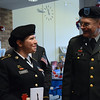 Sergeant Nakita Shaffer and Rev. David Ellis speak with laughter as they wait in line for lunch. Photo by Debby High