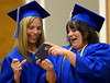 Bob Raines--Montgomery Media<br /> Tracey Drelick, left, and Tiffany Dahm laugh at some of the photos on Dahm's phone before the Lansdale School of Business commencement Friday, May 1, 2015.