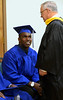 Bob Raines--Montgomery Media<br /> David Heffly, dean of Lansdale School of Business, stops to chat with Blair Clary before commencement. Friday, May 1, 2015.