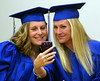 Bob Raines--Montgomery Media<br /> Colleen Carnara, left, and Paula Mullen take a selfie before the start of commencement at Lansdale School of Business Friday, May 1, 2015.
