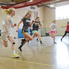The North Middlesex girls softball team runs sprints during an indoor practice on Tuesday. SENTINEL & ENTERPRISE / Ashley Green