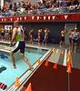 Dean Milligan, Schwenksville, hops into the high school pool to begin the Upper Dublin Triathlon Sunday, May 17, 2015.